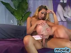 Blond shemale gets blowjob from bald bloke on sofa