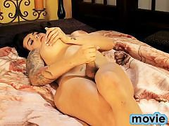 Horny tgirl Stephany masturbating on the bed