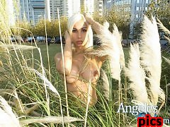 TS Angeles Cid gets naked outdoors
