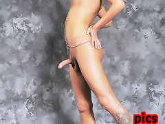 A sexxxy tranny with a long curvy cock posing naked