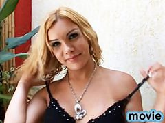 Sexy blonde transsexual posing herself